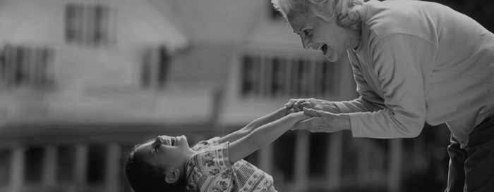 Grandmother dancing with grandchild